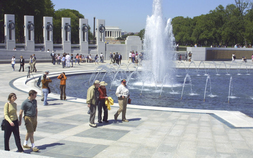 With the Lincoln Memorial in the background, visitors tour the World War II Memorial in Washington, Thursday, April 29, 2004. A national monument to the 16 million U.S. men and women who served during World War II opened to the public Thursday. (AP Photo/Adele Starr)