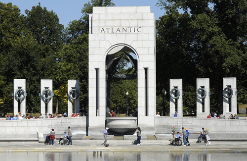 World War II veterans visit the World War II Memorial in Washington, Wednesday, Oct. 2, 2013. It was an act of civil disobedience that marked the fact some barriers nor a government shutdown would keep a group of World War II veterans from visiting the monument erected in their honor. (AP Photo/Susan Walsh)