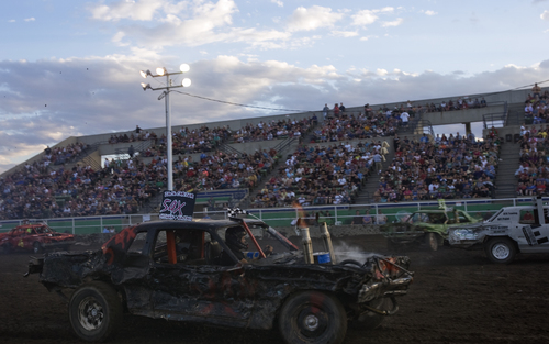 Kim Raff | The Salt Lake Tribune Zack Carter competes in the Demolition Derby on the last day of the Utah State Fair in Salt Lake City, Utah on September 16, 2012.  Legislators are debating what to do with the financially struggling fair.