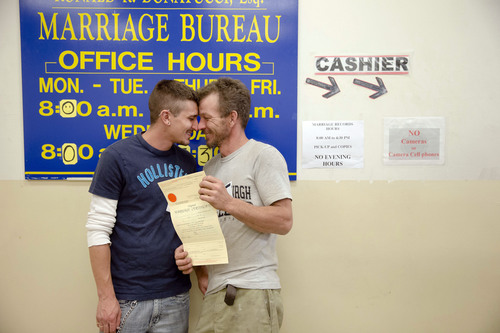William Roletter, left, and Paul Rowe, press close to one another after they had their photo made with their newly acquired marriage certificate, Wednesday, May 21, 2014, at City Hall in Philadelphia. On Tuesday, Pennsylvania became the final Northeastern state and the 19th in the U.S. to legalize same-sex marriage. Republican Gov. Tom Corbett said Wednesday he would not appeal a federal judge's ruling that overturned the state's 1996 ban. (AP Photo/Matt Rourke)