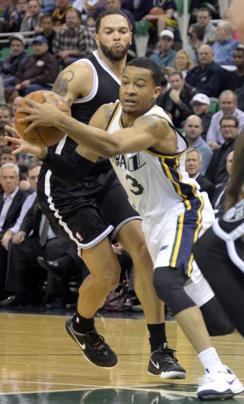 Rick Egan  | The Salt Lake Tribune   Utah Jazz point guard Trey Burke (3) gets past Brooklyn Nets point guard Deron Williams (8), in NBA action, Utah Jazz vs. The Brooklyn Nets, at the EnergySolutions Arena, Wednesday, February 19, 2014.