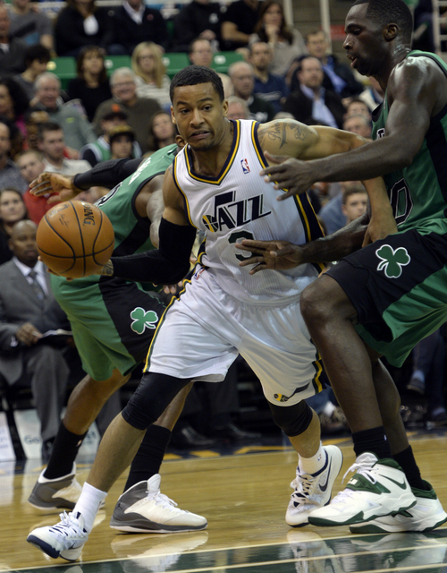 Rick Egan  | The Salt Lake Tribune   Utah Jazz point guard Trey Burke (3) drives around Boston Celtics power forward Brandon Bass (30), in NBA action, at the EnergySolutions Arena, Monday, February 24, 2014.