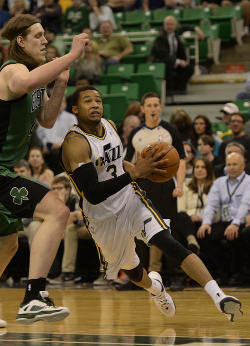 Rick Egan  | The Salt Lake Tribune   Utah Jazz point guard Trey Burke (3) drove under the hoop past Boston Celtics center Kelly Olynyk (41), in NBA action, at the EnergySolutions Arena, Monday, February 24, 2014.