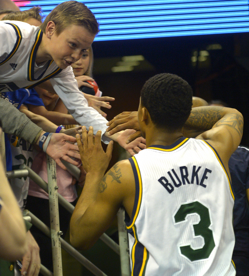 Rick Egan  |  The Salt Lake Tribune  Utah Jazz guard Trey Burke (3) gets high-five's from fans as he leaves the floor after the last home game of the season, The Utah Jazz vs. The Los Angeles Lakers, at EnergySolutions Arena, Monday, April 14, 2014