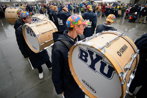 Trent Nelson  |  The Salt Lake Tribune Members of the BYU marching band wear Hawaiian style caps in the rain as BYU hosts Idaho State, college football at LaVell Edwards Stadium in Provo, Saturday November 16, 2013.