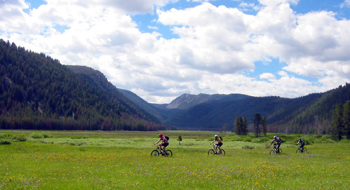 This image provided by Chris Cook shows mountain bikers crossing Warm Springs meadow on the Warm Springs Trail in the proposed Boulder-White Clouds wilderness area in central Idaho near Sun Valley in 2004. Mountain bikers would be barred from this area under a bill gaining steam in Congress. Since the 1980s, the legal definition of wilderness has prohibited mechanized transportation like ATVs, dirt bikes and, inexplicably to some, mountain bikes. (AP File Photo/Chris Cook)