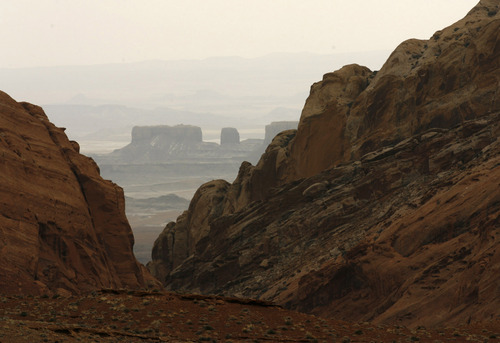 Leah Hogsten | Tribune File Photo A view of the Sand Rafael Swell looking east through Cistern Canyon.   Located in southeastern Utah, Emery County is 4,452 square miles of red rock canyons, mountain meadows of sagebrush and wildflowers, desert wilderness, slot canyons and unforgiving badlands. Settled in 1877, the county is colored with ancient Native American artifacts and rock art, dinosaur bones, outlaw hideouts and abandoned Uranium mines.  Photo by Leah Hogsten 2/16/06 Emery County