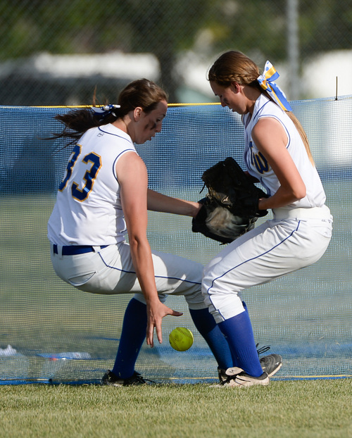 Francisco Kjolseth  |  The Salt Lake Tribune Taylorsville's Tasia Taylor, left, looks to get the ball after a missed catch by Kaylee Wengren as they compete against Lehi for the 5A softball championship at the Valley Softball Complex in Taylorsville on Thursday, May 22, 2014.