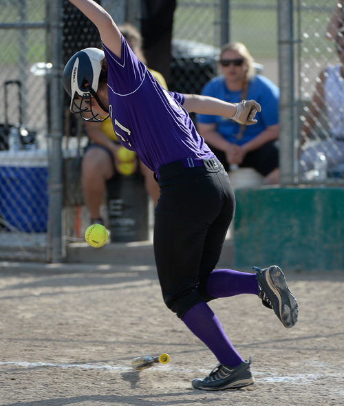 Francisco Kjolseth  |  The Salt Lake Tribune Lehi's Kacie Freudenberger avoides a close call with her bunt hit during the game against Taylorsville for the 5A softball championship at the Valley Softball Complex in Taylorsville on Thursday, May 22, 2014.