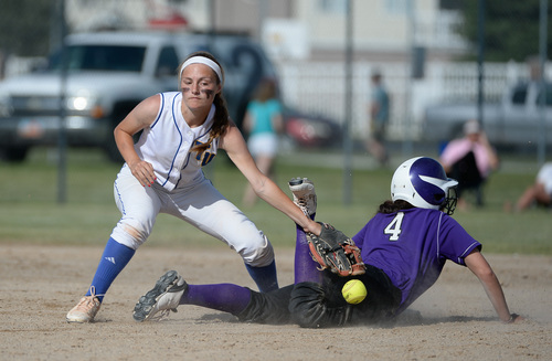 Francisco Kjolseth  |  The Salt Lake Tribune Lehi's Taylor Tahbo gets lucky with a lose ball by Karlee Jensen at second base during the battle for the 5A softball championship at the Valley Softball Complex in Taylorsville on Thursday, May 22, 2014.