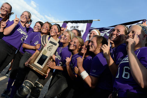 Francisco Kjolseth  |  The Salt Lake Tribune Lehi celebrates their championship win over Taylorsville for the 5A softball championship at the Valley Softball Complex in Taylorsville on Thursday, May 22, 2014.