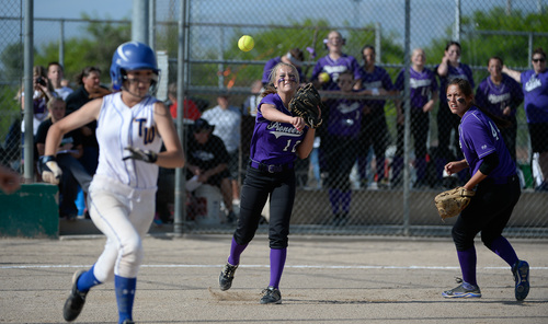 Francisco Kjolseth  |  The Salt Lake Tribune Lehi pitcher Sydney White manages a quick turn for an out at first against Taylorsville for the 5A softball championship at the Valley Softball Complex in Taylorsville on Thursday, May 22, 2014.