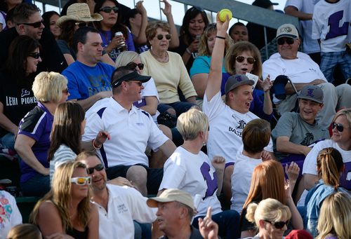 Francisco Kjolseth  |  The Salt Lake Tribune A Lehi fan raises his prize as his team battles Taylorsville for the 5A softball championship at the Valley Softball Complex in Taylorsville on Thursday, May 22, 2014.