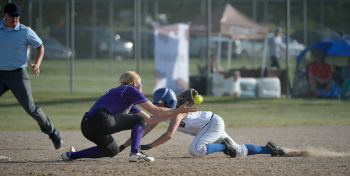 Francisco Kjolseth  |  The Salt Lake Tribune Lehi's Rylin Roberts gains an upper hand over Taylorsville for the 5A softball championship at the Valley Softball Complex in Taylorsville on Thursday, May 22, 2014.