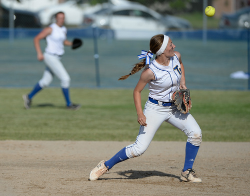 Francisco Kjolseth  |  The Salt Lake Tribune Taylorsville's Karlee Jensen tries to regain control of a ball against Lehi for the 5A softball championship at the Valley Softball Complex in Taylorsville on Thursday, May 22, 2014.