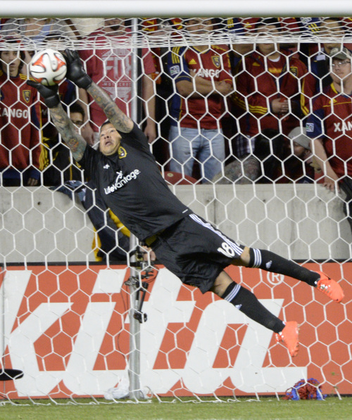 Rick Egan  |  The Salt Lake Tribune  Real Salt Lake goalkeeper Nick Rimando,  makes a save with minutes left in the game, in MLS soccer action, Salt Lake vs. Portland, Saturday, April 19, 2014.