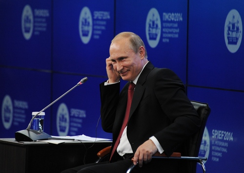"""Russian President Vladimir Putin listens during the St.Petersburg International Investment Forum in St Petersburg, Russia, Friday, May 23, 2014. Speaking at the investment forum, Putin blamed the West for encouraging a """"coup"""" in Ukraine, when the nation's pro-Russian president was chased from power after months of protests. He said that Ukraine is now facing """"chaos and a full-scale civil war.""""  (AP Photo/RIA Novosti Kremlin, Mikhail Klimentyev, Presidential Press Service)"""