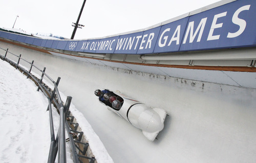 Francisco Kjolseth  | Tribune file photo A professional pilot takes a group of three passengers for the ride of their lives as they fly down the Olympic track in Park City late in 2012.