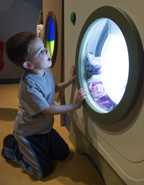 Rick Egan  |  The Salt Lake Tribune Jax Snook, 4, Lehi, in the Suds n' Bubbles room, at the Museum of Natural Curiosity, at Thanksgiving Point last week.