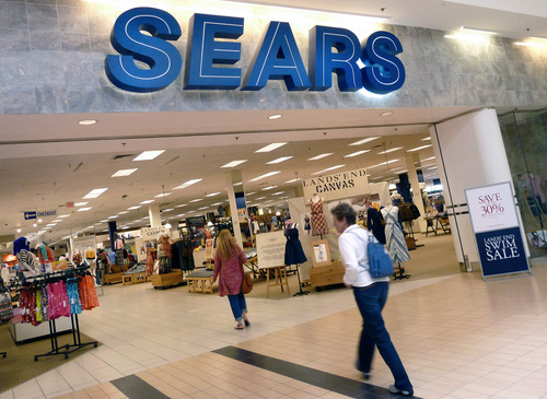FILE - In this Monday, May 14, 2012, file photo, shoppers walk into Sears in Peabody, Mass. Sears reports quarterly earnings on Thursday, May 22, 2014. (AP Photo/Elise Amendola, File)
