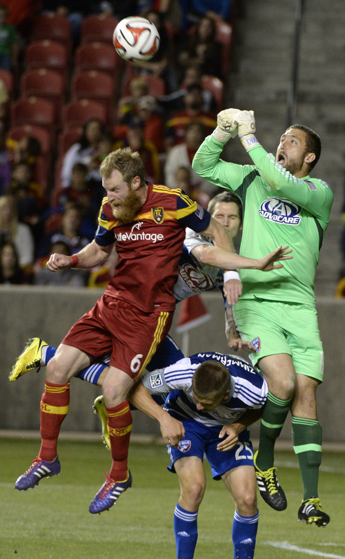 Rick Egan  |  The Salt Lake Tribune  Real Salt Lake defender Nat Borchers (6) goes for the ball as goalkeeper Chris Seitz (18) and Walker Zimmerman (25) defend for Dallas, , in MLS soccer action, Real Salt Lake vs. FC Dallas, at Rio Tinto Stadium, Saturday, May 24, 2014