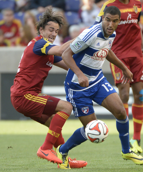 Rick Egan  |  The Salt Lake Tribune  Real Salt Lake midfielder Cole Grossman (12) defends as FC Dallas forward Tesho Akindele (13) goes for the ball, in MLS soccer action, Real Salt Lake vs. FC Dallas, at Rio Tinto Stadium, Saturday, May 24, 2014