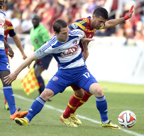 Rick Egan  |  The Salt Lake Tribune  Real Salt Lake midfielder Javier Morales (11) goes for the ball along with FC Dallas defender Zach Loyd (17), in MLS soccer action, Real Salt Lake vs. FC Dallas, at Rio Tinto Stadium, Saturday, May 24, 2014