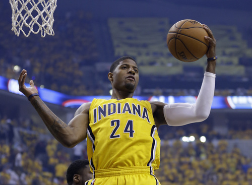 Indiana Pacers' Paul George grabs a rebound during the first half of Game 2 of the NBA basketball Eastern Conference finals against the Miami Heat in Indianapolis, Tuesday, May 20, 2014. (AP Photo/Michael Conroy)