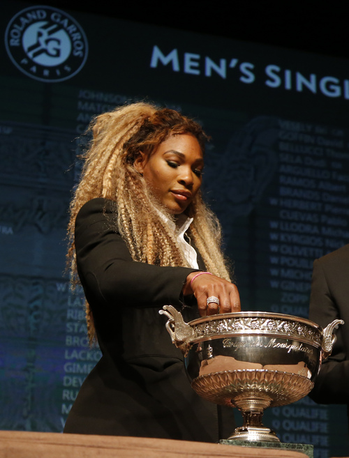 Defending champion Serena Williams, of the U.S, picks up a token during the Men's singles draw for the French Open Tennis tournament, at the Roland Garros stadium in Paris, Friday, May 23, 2014. The French Open tennis tournament starts Sunday. (AP Photo/Michel Euler)