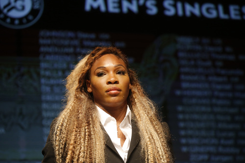 Defending champion Serena Williams, of the U.S,  attends the Men's singles draw for the French Open Tennis tournament, at the Roland Garros stadium in Paris, Friday, May 23, 2014. The French Open tennis tournament starts Sunday. (AP Photo/Michel Euler)