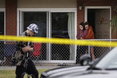 Two women comfort each other near the scene of a shooting on Saturday, May 24, 2014, in Isla Vista, Calif. A drive-by shooter went on a rampage near a Santa Barbara university campus that left seven people dead, including the attacker, and seven others wounded, authorities said Saturday. (AP Photo/Jae C. Hong)