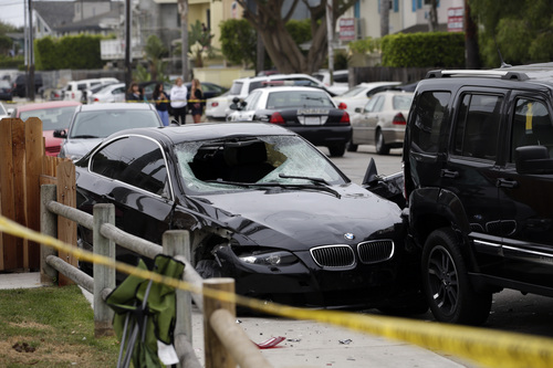 A black BMW sedan driven by a drive-by shooter is seen on Saturday, May 24, 2014, in Isla Vista, Calif. The shooter went on a rampage near a Santa Barbara university campus that left seven people dead, including the attacker, and seven others wounded, authorities said Saturday. (AP Photo/Jae C. Hong)