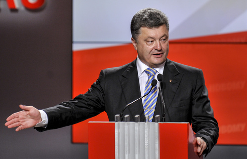 Ukrainian presidential candidate Petro Poroshenko speaks during his press conference in Kiev, Ukraine, Sunday, May 25, 2014. An exit poll showed that billionaire candy-maker Petro Poroshenko won Ukraine's presidential election outright Sunday in the first round — a vote that authorities hoped would unify the fractured nation. (AP Photo/Mykola Lazarenko, Pool)