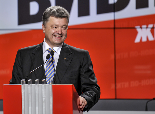 Ukrainian presidential candidate Petro Poroshenko  smiles during his press conference in Kiev, Ukraine, Sunday, May 25, 2014. An exit poll showed that billionaire candy-maker Petro Poroshenko won Ukraine's presidential election outright Sunday in the first round — a vote that authorities hoped would unify the fractured nation. (AP Photo/Mykola Lazarenko, Pool)