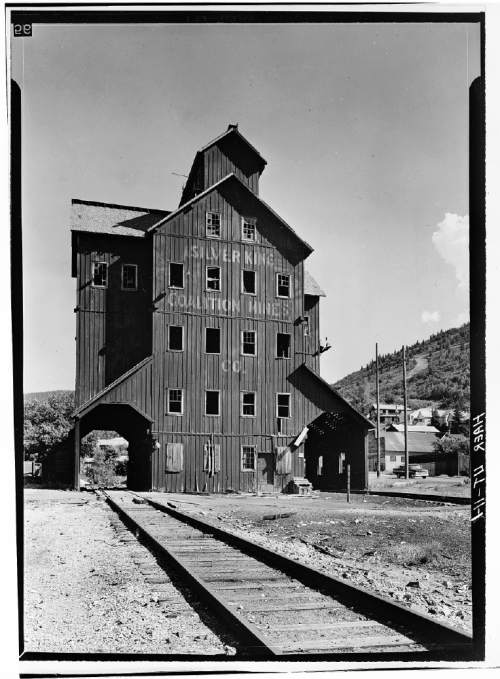 OVERALL VIEW OF MINE SITE, SHOWING MINE CAR TRACKS, SNOWSHEDS AND TIPPLE (LEFT BACKGROUND). VIEW TO EAST. - Park Utah Mining Company: Keetley Mine Complex, 1 mile East of U.S. 40 at Keetley, Heber City, Wasatch County, UT