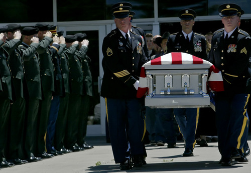Chris Detrick     Tribune file photo Soldiers in Cedar City carry the casket of Sgt. 1st Class Ron Wood on July 26, 2005. The VA is looking for a place to put a new veterans burial ground in or near Cedar City.