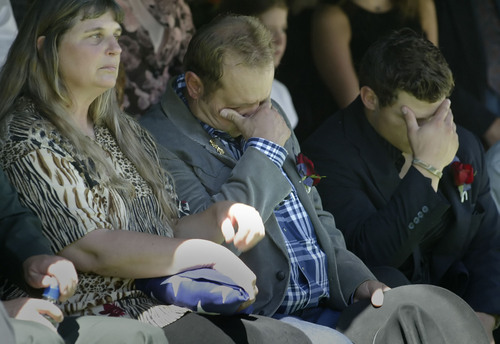 Chris Detrick     Tribune file photo   FROM LEFT: Parents Jody, Ron, and brother Cody Wood get emotional during the interment ceremony held at the Hurricane Cemetery for Sgt. 1st Class Ronald Wood on July 26, 2005. The VA is looking for a place to put a new veterans burial ground in or near Cedar City.