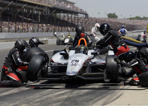 Kurt Busch pits during the 98th running of the Indianapolis 500 IndyCar auto race at the Indianapolis Motor Speedway in Indianapolis, Sunday, May 25, 2014. (AP Photo/R Brent Smith)