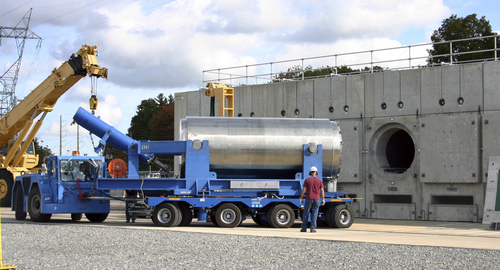 In this Oct. 14, 2010 photo released by Dominion Resources, a trailer holding a spent fuel storage container is maneuvered into position for offloading into a horizontal storage module at the Millstone Power Station in Waterford, Conn. With the collapse of a proposal for nuclear waste storage at Nevada's Yucca Mountain, Millstone and other plants across the country are building or expanding on-site storage for waste. (AP Photo/Dominion Resources)