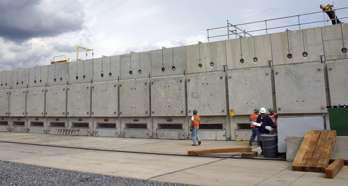 This Oct. 3, 2008 photo released by Dominion Resources, shows some of the 19 horizontal storage modules that hold spent fuel storage containers at the Millstone Power Station in Waterford, Conn. With the collapse of a proposal for nuclear waste storage at Nevada's Yucca Mountain, Millstone and other plants across the country are building or expanding on-site storage for waste. (AP Photo/Dominion Resources)