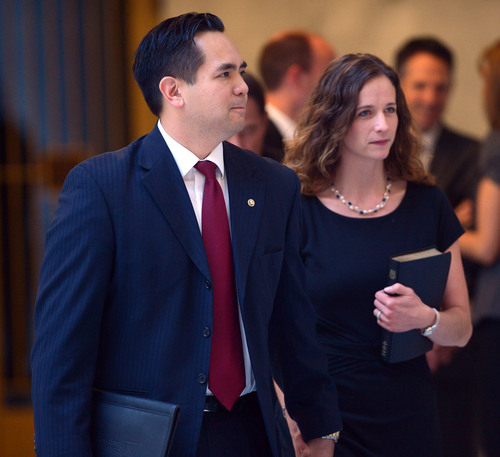 Steve Griffin  |  Tribune file photo  Sean Reyes walks to the podium with his wife, Saysha Reyes, before being sworn in as attorney general at the Utah State Capitol Rotunda in Salt Lake City Monday, Dec. 30, 2013.