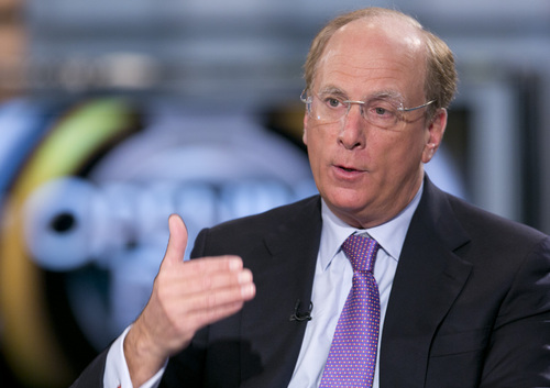 """FILE - In this March 26, 2014 file photo, BlackRock Chairman and CEO Laurence Fink is interviewed by Maria Bartiromo on Fox Business Network's """"Opening Bell with Maria Bartiromo,"""" in New York. The average pay of a Wall Street CEO went up by 22 percent in 2013, on top of the 22 percent increase the year before. Fink was the best paid with a pay package of $22.9 million. (AP Photo/Mark Lennihan, File)"""