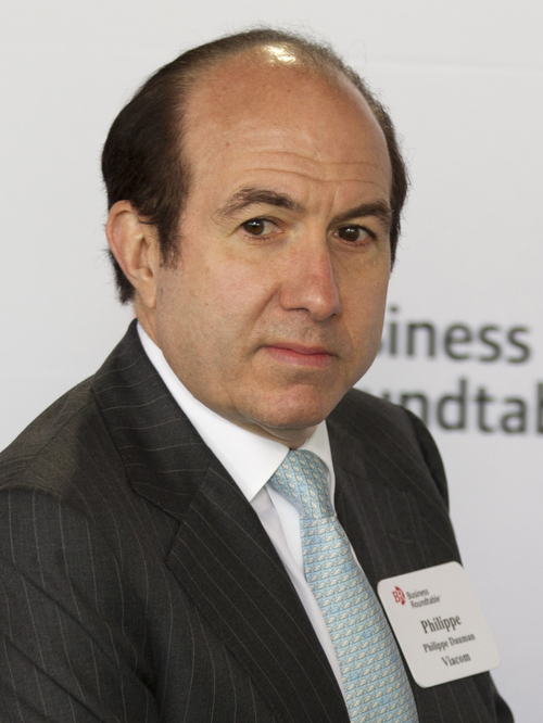 FILE - In this June 13, 2012 file photo, Viacom CEO Philippe Dauman arrives for the start of an event with Republican presidential candidate, former Massachusetts Gov. Mitt Romney during the Business Roundtable quarterly meeting at the Newseum in Washington. Dauman made $37.2 million in 2013, making him the fifth highest-paid CEO, according to an AP/Equilar analysis. (AP Photo/Evan Vucci, File)