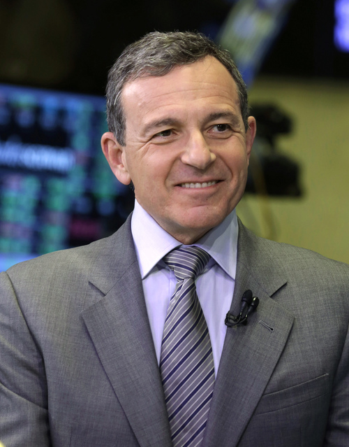 FILE - In this Tuesday, March 12, 2013, file photo, Bob Iger, chairman and CEO of The Walt Disney Company, is interviewed on the floor of the New York Stock Exchange. Iger was the seventh highest paid CEO in 2013 at $34.3 million, as calculated by The Associated Press and Equilar, an executive pay research firm. (AP Photo/Richard Drew, File)