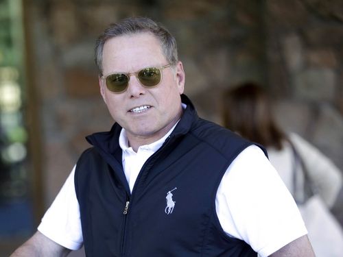 FILE - In this July 9, 2013 file photo, David Zaslav, president and chief executive officer of Discovery Communications Inc., arrives at the Allen & Company Sun Valley Conference in Sun Valley, Idaho. Zaslav was the eighth highest paid CEO in 2013 at $33.3 million, as calculated by The Associated Press and Equilar, an executive pay research firm. (AP Photo/Rick Bowmer, File)