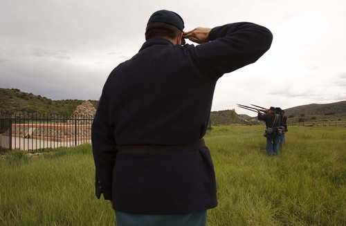 Mountain Meadows - Kent Dunlap leads an honor guard made up of descendants of the Mountain Meadows Massacre survivors, firing a 21 gun salute during a commemoration at the site on Saturday May 30, 2009. Trent Nelson/The Salt Lake Tribune