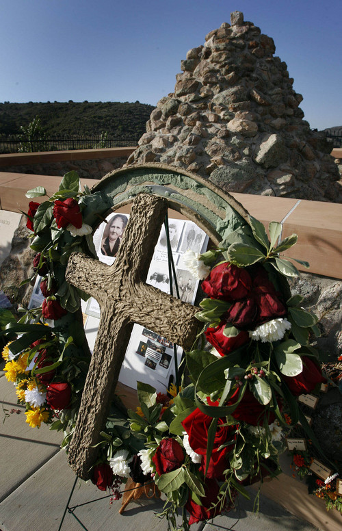 Steve Griffin  |  Tribune file photo  Flowers and photos were placed at the Mountain Meadows Memorial Grave Site by descendants and loved ones of the victims of the massacre, during the Mountain Meadows Massacre Memorial near Enterprise, Utah, Sept. 11, 2007.  The massacre happened on Sept. 11, 1857.