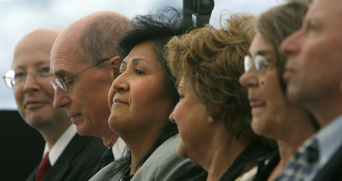Steve Griffin  |  Tribune file photo Lora Tom, representing the Paiute Tribe, is applauded following her speech during the Mountain Meadows Massacre Memorial near Enterprise, Utah, Sept. 11, 2007.