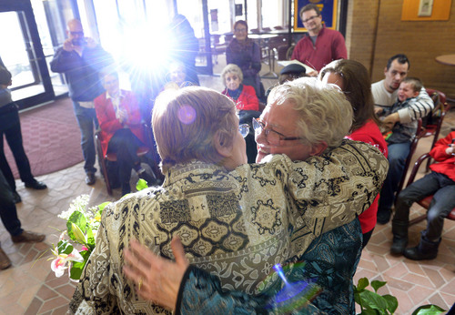 Francisco Kjolseth  |  The Salt Lake Tribune Andrea Dahl, 56, center, and her partner of 25-years Coral Mangus, 63, are married in the lobby of the Salt Lake County offices by Reverend Patty Willis on Monday, Dec. 23, 2013 surrounded by friends and family. Mangus and Dahl joined hundreds of other same-sex couples at the Salt Lake County offices to request marriage licenses with numerous officiants performing wedding ceremonies right after. A federal judge in Utah struck down the state's ban on same-sex marriage last Friday, saying the law violates the U.S. Constitution's guarantees of equal protection and due process.