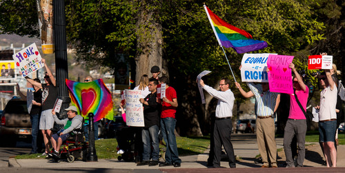 Trent Nelson  |  The Salt Lake Tribune Citizens show their support of marriage equality, holding signs and waving to traffic in front of the City & County Building in Salt Lake City, Thursday April 10, 2014.
